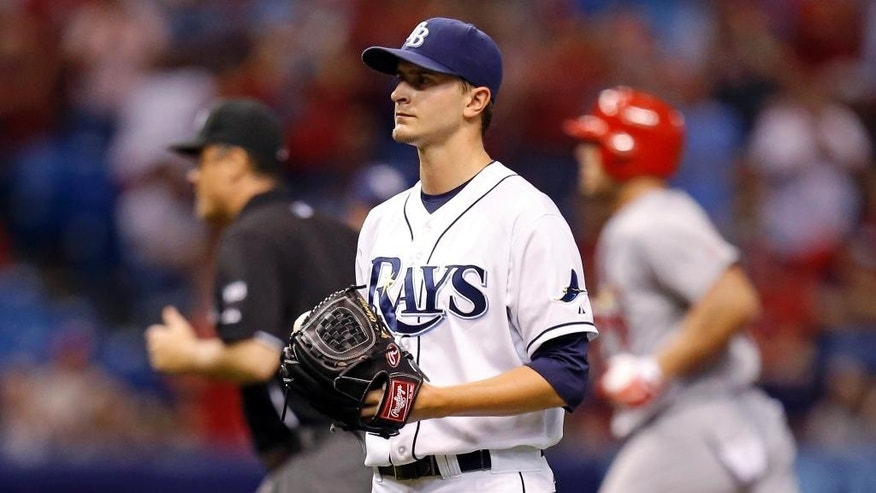 Tampa Bay Rays starting pitcher Jake Odorizzi reacts after giving up a solo home run to St. Louis Cardinals' Matt Holliday during the sixth inning of a baseball game Tuesday, June 10, 2014, in St. Petersburg, Fla. (AP Photo/Mike Carlson)
