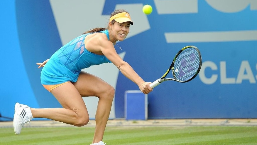 Serbia's Ana Ivanovic on her way to defeating  Germany's Mona Barthel, during the Aegon Classic tennis tournament  at the Edgbaston Priory Club, Birmingham England Tuesday June 10, 2014. (AP Photo/ Martin Rickett/PA) UNITED KINGDOM OUT