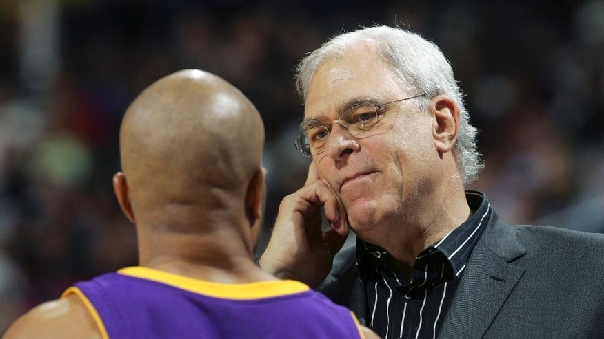 "FILE - In this Nov. 1, 2008 file photo, Los Angeles Lakers coach Phil Jackson talks with Derek Fisher during the second half of an NBA basketball game against the Denver Nuggets in Denver. Fisher has agreed to become the next coach of the New York Knicks and will be introduced at a news conference Tuesday morning, June 10, 2014, a person familiar with the situation told The Associated Press. The Knicks did not confirm the hiring, other than saying they were planning a ""major announcement. Jackson is now the Knicks president.  (AP Photo/Jack Dempsey, File)"