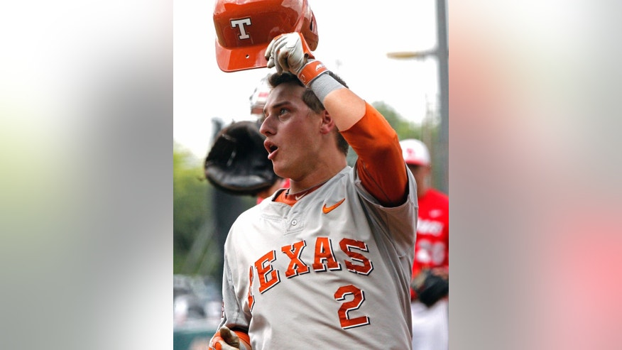 Texas's Mark Payton tips his helmet after hitting a home run against Houston in the first inning of an NCAA college baseball tournament super regional game in  Austin, Texas, Friday, June 6, 2014.  (AP Photo/Michael Thomas)