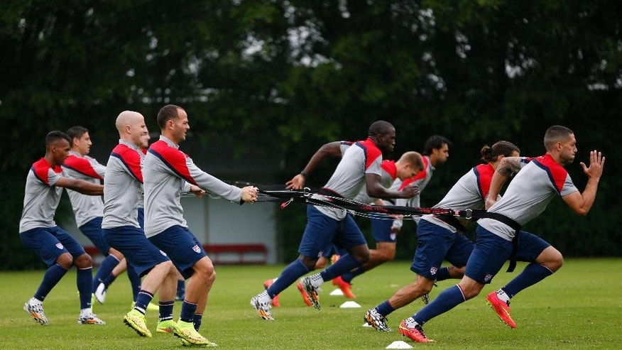 United States players work on resistance exercises during a training session at the Sao Paulo FC training center in Sao Paulo, Brazil, Tuesday, June 10, 2014. The U.S. will play in group G of the 2014 soccer World Cup. (AP Photo/Julio Cortez)
