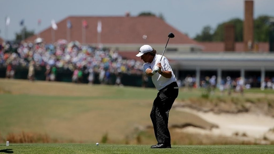 Phil Mickelson hits his tee shot on the 18th hole during a practice round for the U.S. Open golf tournament in Pinehurst, N.C., Tuesday, June 10, 2014. The tournament starts Thursday. (AP Photo/Chuck Burton)