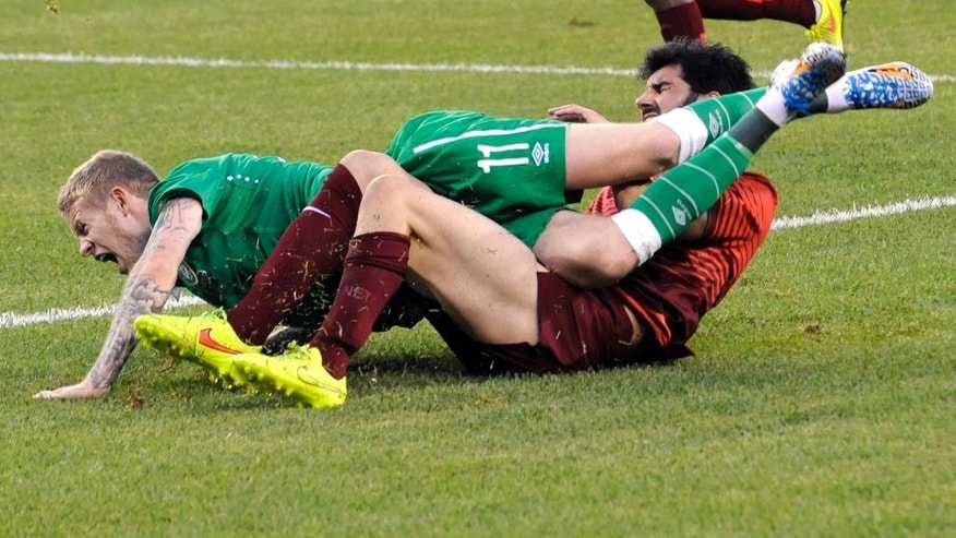 Republic of Ireland's James McClean (11) collides with Portugal's Luis Neto during the first half of an international friendly soccer match Tuesday, June 10, 2014, in East Rutherford, N.J. (AP Photo/Bill Kostroun)