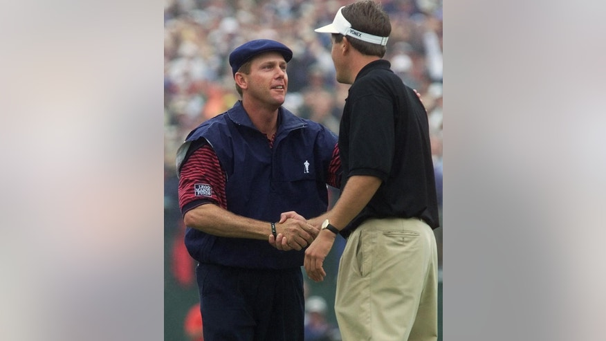 ADVANCE FOR WEEKEND EDITIONS, JUNE 7-8 - FILE - In this June 20, 1999, file photo, Phil Mickelson, right, congratulates Payne Stewart  after Stewart won the U.S. Open golf tournament at the Pinehurst Resort & Country Club's No. 2 course in Pinehurst, N.C. No one has ever had so many chance in one major without ever winning it. Somehow, Mickelson is as optimistic as ever. (AP Photo/Doug Mills, File)