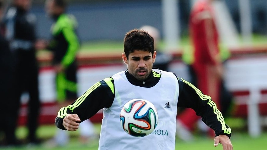 Diego Costa controls the ball during a training session of the Spanish national team at the Atletico Paranaense training center in Curitiba, Brazil, Monday, June 9, 2014. Spain will play in group B of the Brazil 2014 World Cup. (AP Photo/Manu Fernandez)