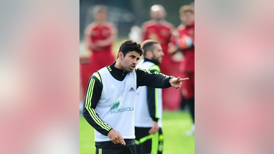 Spain's Diego Costa gestures during a training session at the Atletico Paranaense training center in Curitiba, Brazil, Monday, June 9, 2014. Spain will play in group B of the Brazil 2014 World Cup. (AP Photo/Manu Fernandez)
