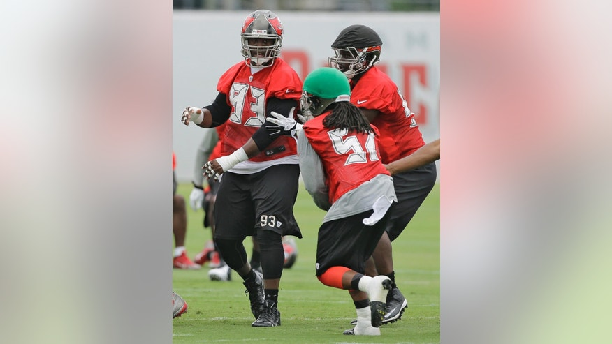 Tampa Bay Buccaneers defensive tackle Gerald McCou (93) works against linebacker Damaso Munoz (57) and defensive tackle Euclid Cummings (95) during an NFL football minicamp Wednesday, June 11, 2014, in Tampa, Fla. (AP Photo/Chris O'Meara)