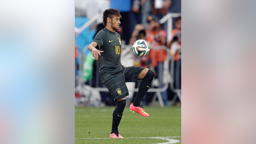 Brazil's Neymar controls the ball during an official training session the day before the group A World Cup soccer match between Brazil and Croatia in the Itaquerao Stadium, Sao Paulo       , Brazil, Wednesday, June 11, 2014.  (AP Photo/Andre Penner)