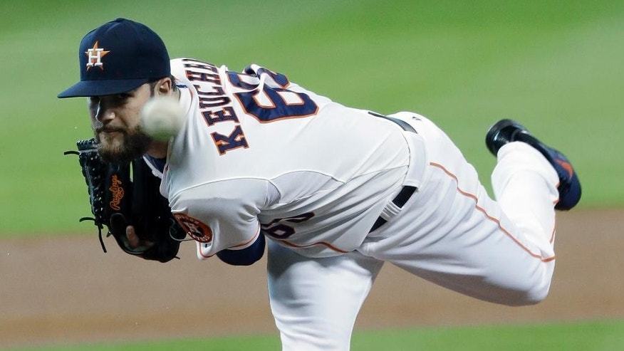 Houston Astros' Dallas Keuchel delivers a pitch against the Arizona Diamondbacks in the first inning of a baseball game Wednesday, June 11, 2014, in Houston. (AP Photo/Pat Sullivan)