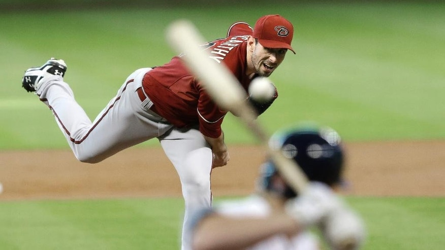 Arizona Diamondbacks' Brandon McCarthy delivers a pitch to Houston Astros' Matt Dominguez in the first inning of a baseball game Wednesday, June 11, 2014, in Houston. (AP Photo/Pat Sullivan)