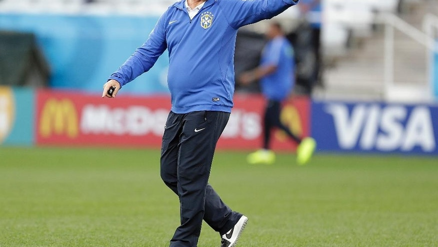 Brazil's coach Luiz Felipe Scolari gestures during an official training session the day before the group A World Cup soccer match between Brazil and Croatia in the Itaquerao Stadium, Sao Paulo       , Brazil, Wednesday, June 11, 2014.  (AP Photo/Andre Penner)