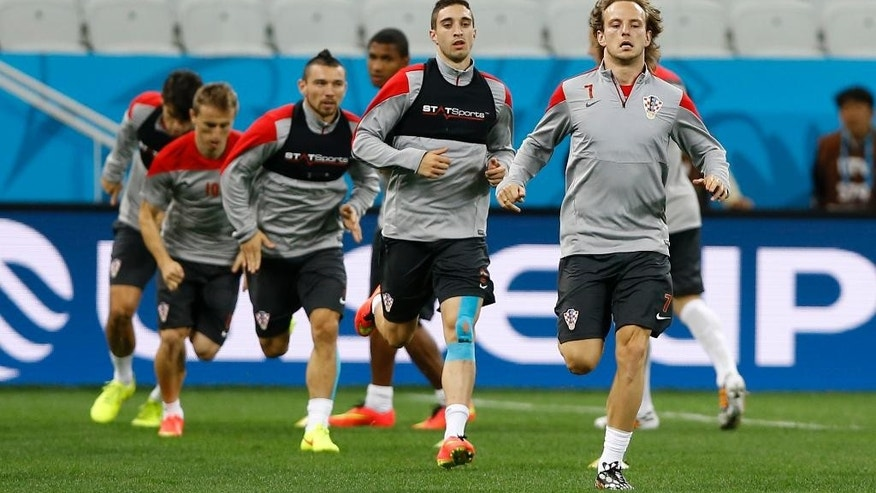 Croatia's players run during an official training session the day before the group A World Cup soccer match between Brazil and Croatia at the Itaquerao Stadium in Sao Paulo, Brazil, Wednesday, June 11, 2014. (AP Photo/Kirsty Wigglesworth)