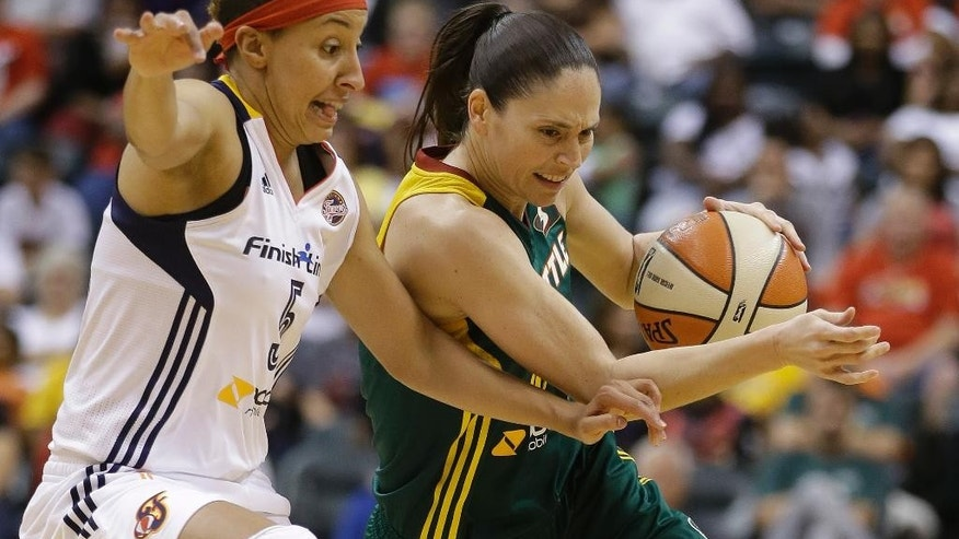 Seattle Storm's Sue Bird, right, is defended by Indiana Fever's Layshia Clarendon during the second half of a WNBA basketball game on Wednesday, June 11, 2014, in Indianapolis. Indiana defeated Seattle 76-68. (AP Photo/Darron Cummings)