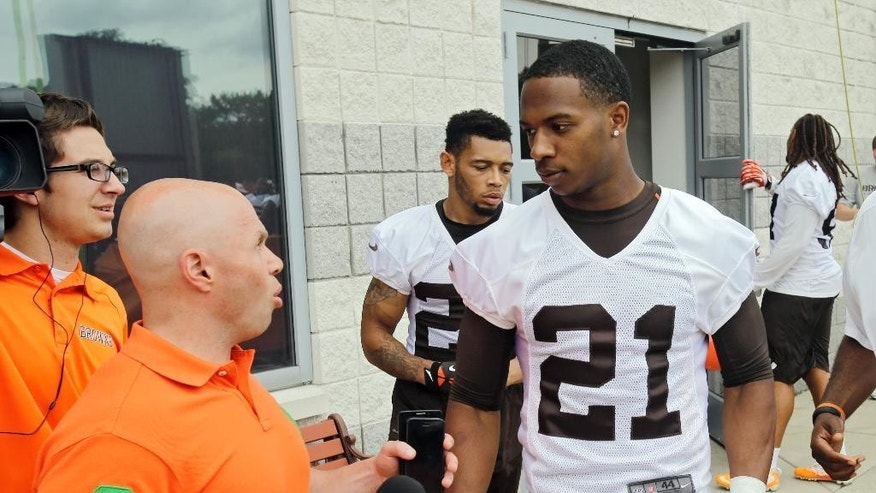 Cleveland Browns cornerback Justin Gilbert (21) talks with the team's reporter after a mandatory minicamp practice at the NFL football team's facility in Berea, Ohio, Wednesday, June 11, 2014. The Browns selected Gilbert early in the first round, before quarterback Johnny Manziel, hoping that by putting him on the opposite side of Pro Bowler Joe Haden, back center, they can shut down passing games. (AP Photo/Mark Duncan)