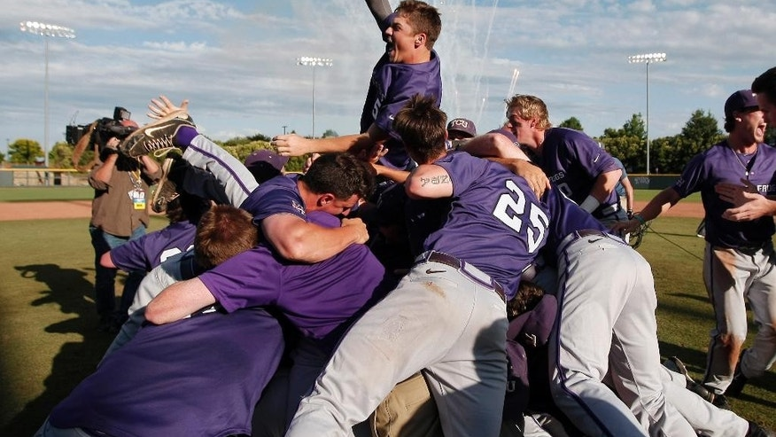 The TCU mens baseball team celebrate their 6-5 win over Pepperdine in an NCAA college baseball tournament super regional game in Fort Worth, Texas, Monday, June 9, 2014. (AP Photo/Brandon Wade)