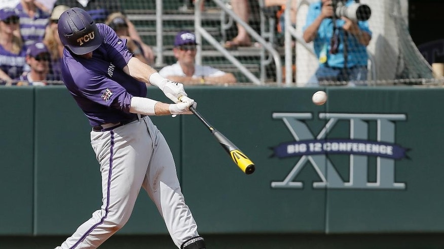 TCU's Kevin Cron makes contact for a solo-home to left field during the fifth inning of an NCAA college baseball tournament super regional game against Pepperdine in Fort Worth, Texas, Monday, June 9, 2014. TCU won 6-5. (AP Photo/Brandon Wade)