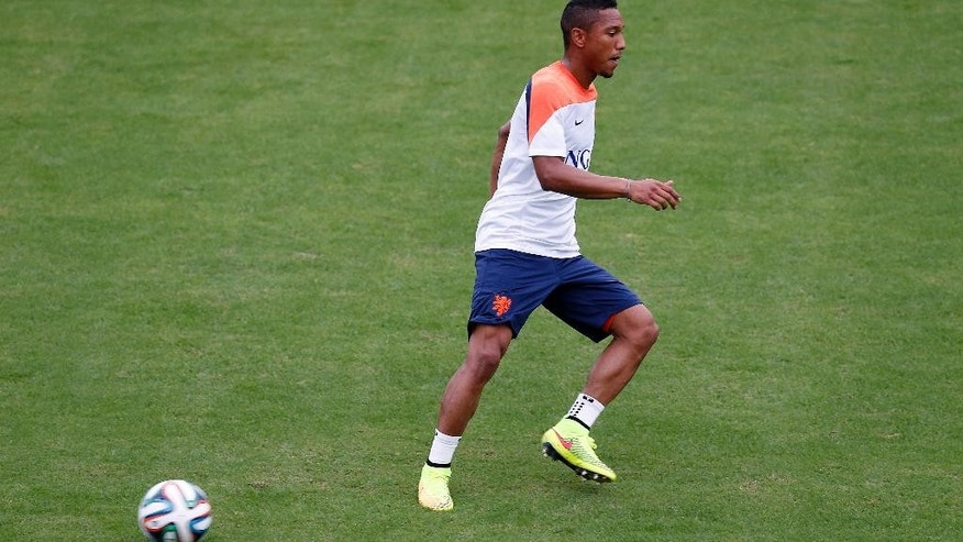 In this June 10, photo, Jonathan de Guzman of the Netherlands is seen during a training session in Rio de Janeiro, Brazil. Jonathan de Guzman appears to have fully recovered from a hamstring strain and to be fit enough to play in the Netherlands' crucial Group B opener against defending champion Spain of Friday. (AP Photo/Wong Maye-E)