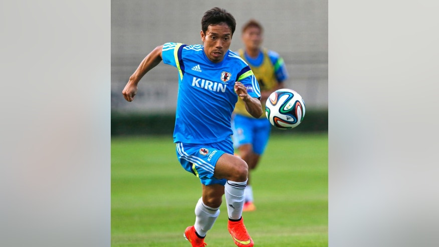In this June 8, 2014 photo, Japan's Yuto Nagatomo controls the ball during a training session in Sorocaba, Brazil. Both at Inter and with Japan, Nagatomo's trademark is galloping down the right side in counter-attack and sending in pinpoint crosses, or even scoring himself. (AP Photo/Shuji Kajiyama)