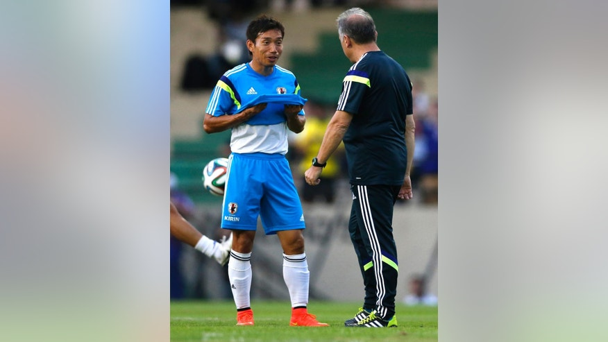 In this June 8, 2014 photo, Japan's Yuto Nagatomo talks to his coach Alberto Zaccheroni during a training session in Sorocaba, Brazil. In the Brazilian heat, Nagatomo's speed and stamina will be a particular asset for Japan, as he is known to wear opponents down with his relentless runs. (AP Photo/Shuji Kajiyama)