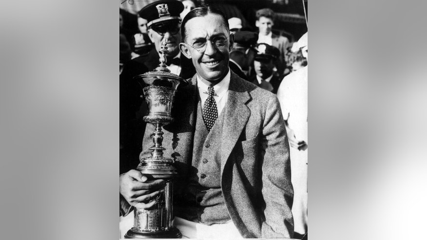 FILE - In this Sept. 5, 1931, file photo, Francis Ouimet of Boston, Ma., poses with his trophy after winning the U.S. Amateur Golf tournament at the Beverly Country Club in Chicago, Ill. In what remains one of the most celebrated U.S. Opens in history, Francis Ouimet put American golf on the map by bringing down two titans. (AP Photo/File)