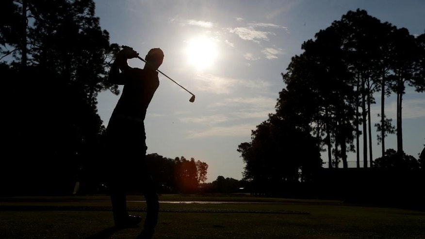 Martin Kaymer, of Germany, watches his tee shot on the third hole during a practice round for the U.S. Open golf tournament in Pinehurst, N.C., Wednesday, June 11, 2014. The tournament starts Thursday. (AP Photo/Chuck Burton)