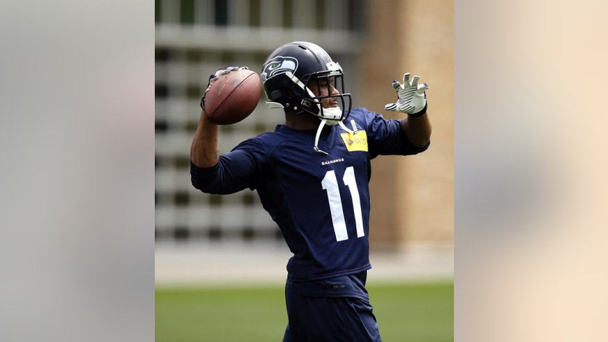 Seattle Seahawks' Percy Harvin returns a ball after a catch at an NFL organized team activity football practice on Thursday, June 12, 2014, in Renton, Wash. (AP Photo/Elaine Thompson)