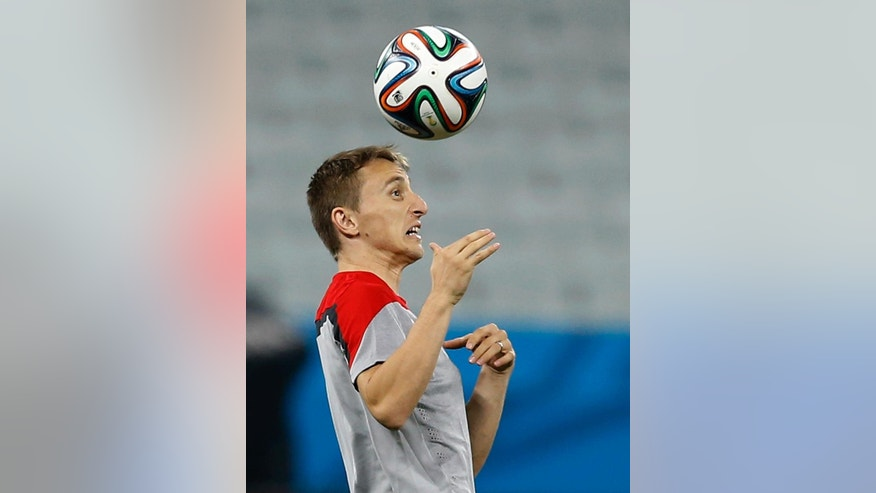 Croatia's Luka Modric plays with the ball during an official training session the day before the group A World Cup soccer match between Brazil and Croatia at the Itaquerao Stadium in Sao Paulo, Brazil, Wednesday, June 11, 2014. (AP Photo/Kirsty Wigglesworth)