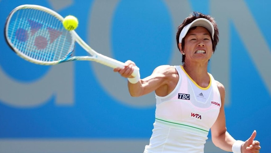 Japan's Kimiko Date-Krumm makes a return to Slovakia's Daniela Hantuchova during the Aegon Classic at Edgbaston Priory Club, Birmingham England Thursday June 12, 2014. (AP Photo/David Davies/PA) UNITED KINGDOM OUT