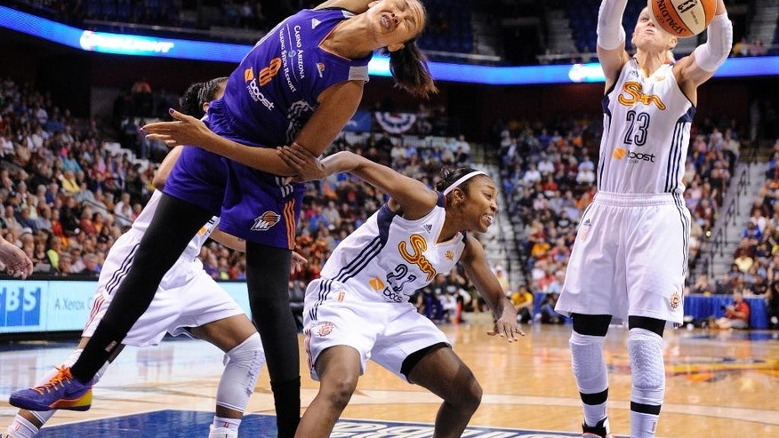 Phoenix Mercury's Mistie Bass (8) fights for a rebound with Connecticut Sun's Renee Montgomery (21) and Katie Douglas (23) during the first half of their WNBA basketball game in Uncasville, Conn., Thursday, June 12, 2014. (AP Photo/Fred Beckham)