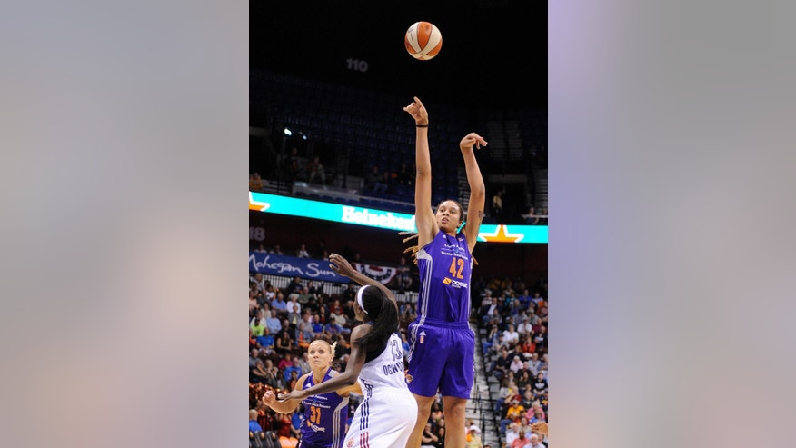 Phoenix Mercury's Brittney Griner (42) shoots over Connecticut Sun's Chiney Ogwumike (13) during the first half of a WNBA basketball game in Uncasville, Conn., Thursday, June 12, 2014. (AP Photo/Fred Beckham)