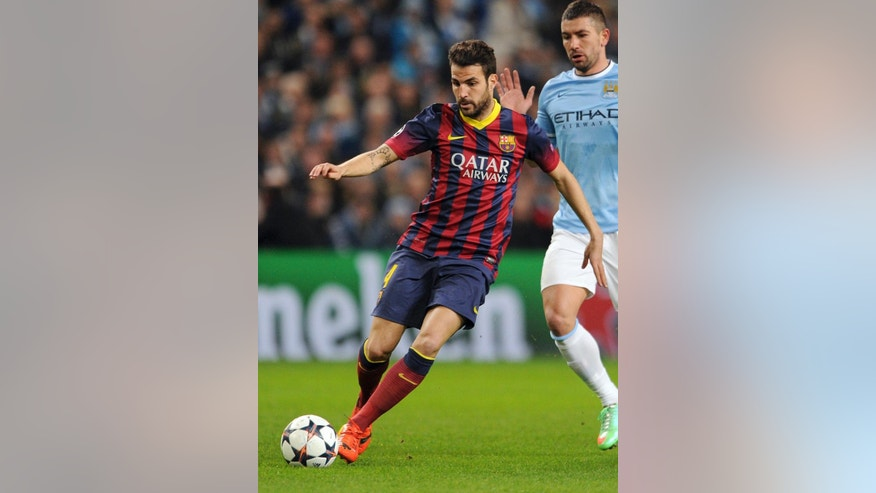 "FILE - A Tuesday, Feb. 18, 2014 photo from files showing Barcelona's Cesc Fabregas during their Champions League Round of 16 soccer match against Manchester City at the Etihad Stadium in Manchester, England.  Chelsea has announced on its website the signing of Cesc Fabregas from Barcelona on a five-year deal. The 27-year-old Fabregas, who has previously played for Chelsea's London rival Arsenal, says ""I do feel that I have unfinished business in the Premier League"" and that Chelsea ""match my footballing ambitions with their hunger and desire to win trophies.""  Fabregas, who is currently with Spain preparing for the World Cup in Brazil, will wear the number four shirt at Chelsea. (AP Photo/Clint Hughes, File)"