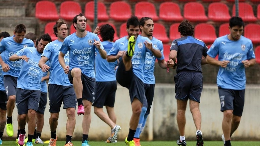 Uruguayan players attend their last training session before their first World Cup match at Arena do Jacare Stadium in Sete Lagoas, Brazil, Thursday, June 12, 2014.  (AP Photo/Bruno Magalhaes)