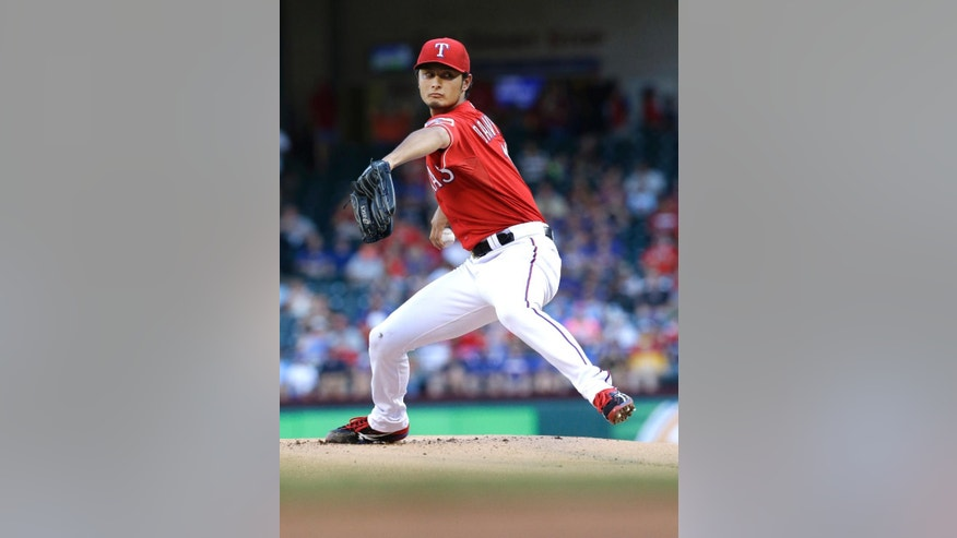 Texas Rangers starting pitcher Yu Darvish, of Japan, throws during the first inning of a baseball game against the Miami Marlins in Arlington, Texas, Wednesday, June 11, 2014. (AP Photo/LM Otero)