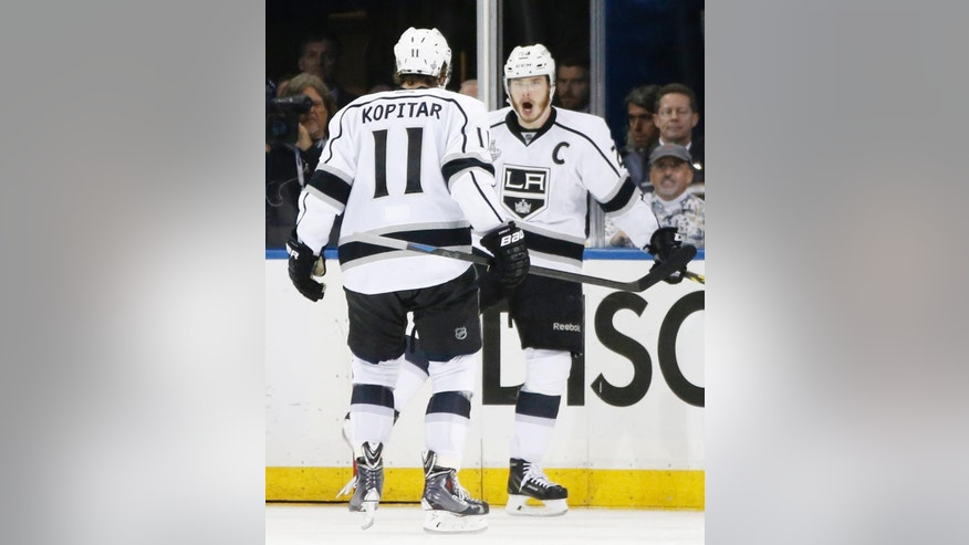 Los Angeles Kings right wing Dustin Brown (23) reacts with center Anze Kopitar (11) after scoring against the New York Rangers in the second period during Game 4 of the NHL hockey Stanley Cup Final, Wednesday, June 11, 2014, in New York. (AP Photo/Kathy Willens)