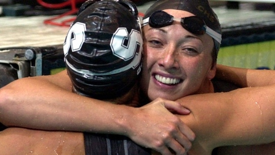 Aug. 16, 2000: In this file photo, Amy Van Dyken, right, of Lone Tree, Colo., hugs Dara Torres of Palo Alto, Calif., after Torres won the finals of the women's 50-meter freestyle at the U.S. Olympic Swimming Trials in Indianapolis. (AP)