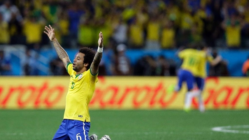 Brazil's Marcelo celebrates after his teammate Oscar scored his sides 3rd goal during the group A World Cup soccer match between Brazil and Croatia, the opening game of the tournament, in the Itaquerao Stadium in Sao Paulo, Brazil, Thursday, June 12, 2014.  (AP Photo/Kirsty Wigglesworth)