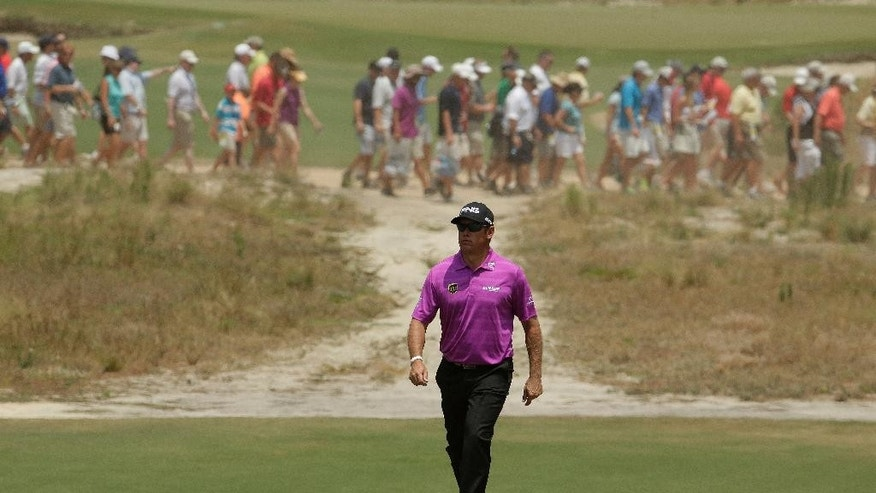 Lee Westwood, of England, walks down the 18th fairway hole during a practice round for the U.S. Open golf tournament in Pinehurst, N.C., Wednesday, June 11, 2014. The tournament starts Thursday. (AP Photo/Charlie Riedel)