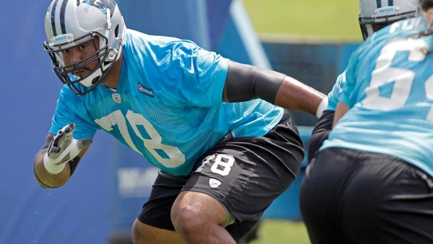 Carolina Panthers' Nate Chandler (78) works during a blocking drill  at an NFL football organized team activity in Charlotte, N.C., Wednesday, June 11, 2014. (AP Photo/Bob Leverone)