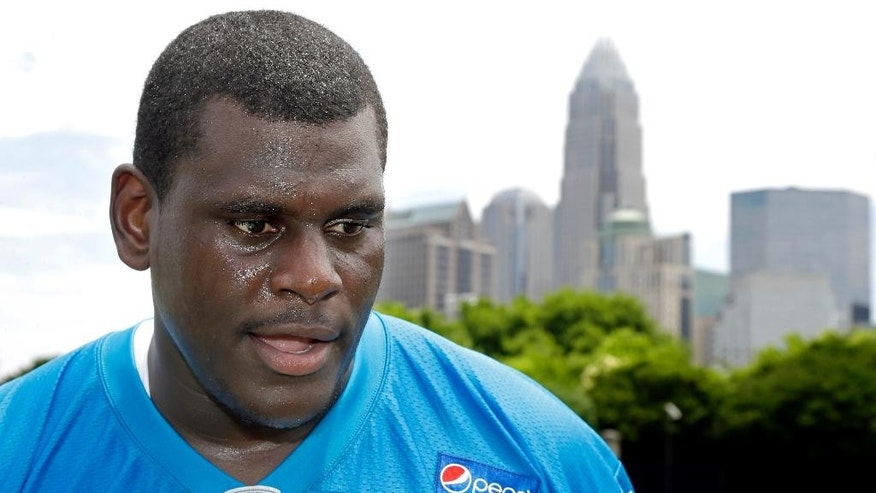 Carolina Panthers' Byron Bell talks with reporters  at an NFL football organized team activity in Charlotte, N.C., Wednesday, June 11, 2014. (AP Photo/Bob Leverone)