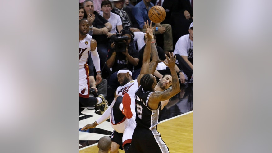 Miami Heat forward LeBron James (6), San Antonio Spurs guard Manu Ginobili, right, and forward Kawhi Leonard (2)  battle for control of a rebound in the first half in Game 4 of the NBA basketball finals, Thursday, June 12, 2014, in Miami. (AP Photo/Wilfredo Lee)
