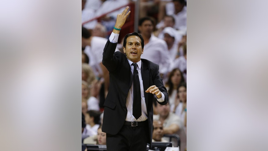 Miami Heat head coach Erik Spoelstra gestures during the first half in Game 4 of the NBA basketball finals against the San Antonio Spurs, Thursday, June 12, 2014, in Miami.  (AP Photo/Lynne Sladky)