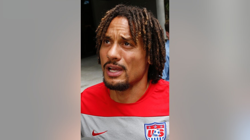 United States' Jermaine Jones talks to media members in Sao Paulo, Brazil, Friday, June 13, 2014.  The U.S. will play in group G of the 2014 soccer World Cup. (AP Photo/Julio Cortez)