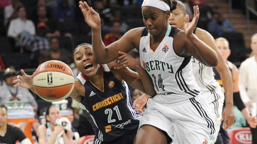 Connecticut Sun guard Renee Montgomery, left, attempts to get around New York Liberty guard Sugar Rodgers to reach a loose ball during the first quarter of a WNBA basketball game Friday, June 13, 2014, at Madison Square Garden in New York. (AP Photo/Bill Kostroun)