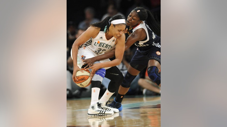 Connecticut Sun forward Chiney Ogwumike, right, attempts to strip the ball from New York Liberty forward Pienette Pierson during the first quarter of a WNBA basketball game Friday, June 13, 2014, at Madison Square Garden in New York. (AP Photo/Bill Kostroun)