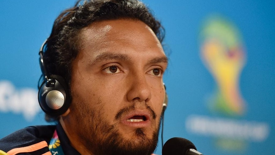 Colombia's Abel Aguilar talks to the media during a press conference on the day before the group C World Cup soccer match between Colombia and Greece at the Mineirao Stadium in Belo Horizonte, Brazil, Friday, June 13, 2014.  (AP Photo/Martin Meissner)