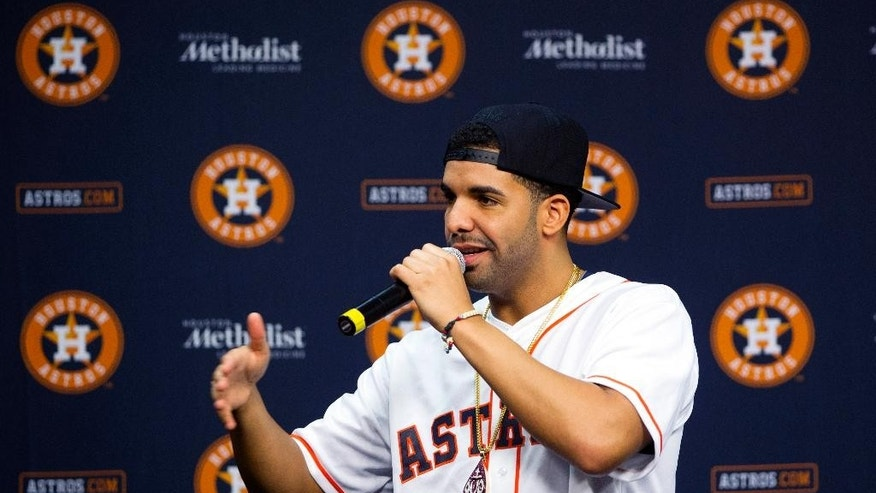 Grammy Award-winning artist Drake speaks at a press conference before a baseball game against the Arizona Diamondbacks and the Houston Astros, Thursday, June 12, 2014, in Houston.  (AP Photo/Patric Schneider)