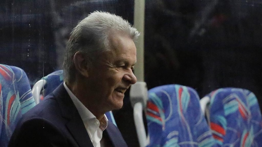 Ottmar Hitzfeld, coach of Switzerland's national team, sits on a bus as he arrives at the Sao Paulo International airport, Brazil, Saturday, June 7, 2014. Switzerland is part of Group E that includes Ecuador, France and Honduras. Switzerland will play Ecuador in Brasilia in its opening match on June 15. (AP Photo/Nelson Antoine)