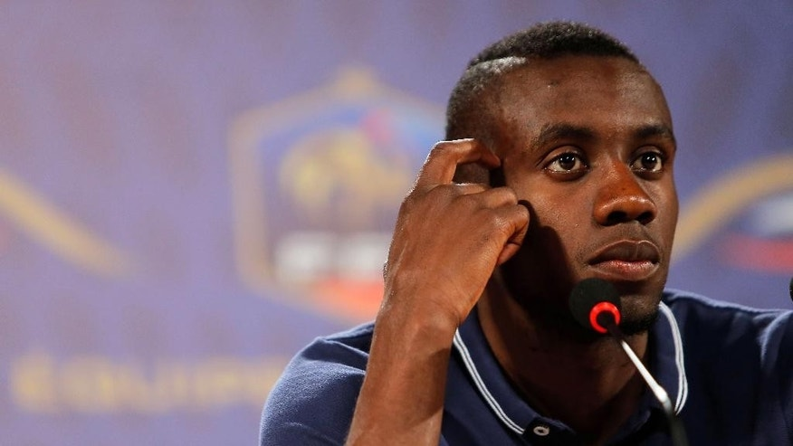 France's player Blaise Matuidi gestures as he answers questions during a press conference in Ribeirao Preto, Brazil, Friday, June 13, 2014. France is in group E at the World Cup soccer tournament and plays its first match Sunday. (AP Photo/David Vincent)