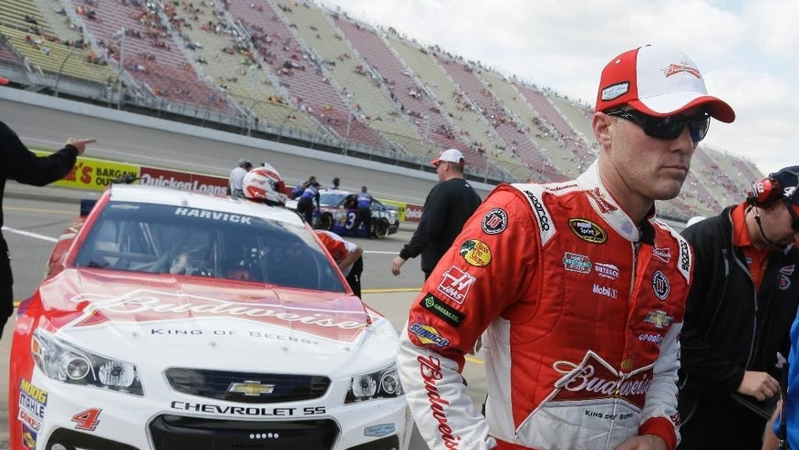 Driver Kevin Harvick is seen in the pit area after winning the pole for Sunday's NASCAR Sprint Cup series Quicken Loans 400 auto race at Michigan International Speedway in Brooklyn, Mich., Friday, June 13, 2014. (AP Photo/Carlos Osorio)