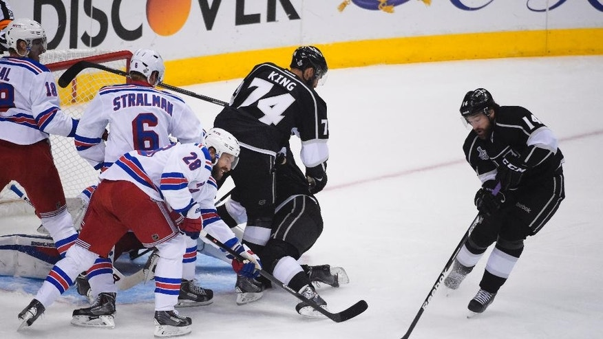 Los Angeles Kings right wing Justin Williams, right, scores a goal against the New York Rangers during the first period in Game 5 of the NHL Stanley Cup Final series Friday, June 13, 2014, in Los Angeles. (AP Photo/Mark J. Terrill)